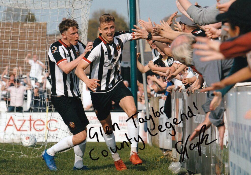 A signed print of Glen Taylor scoring the winner vs Chorley