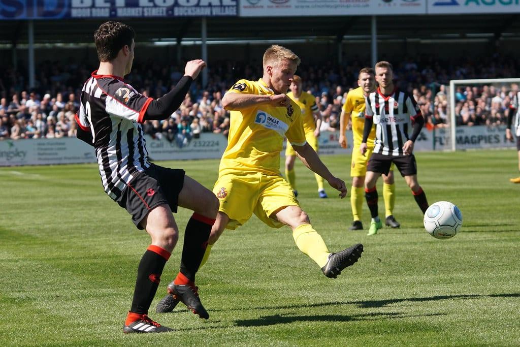 Footballers battle for a ball